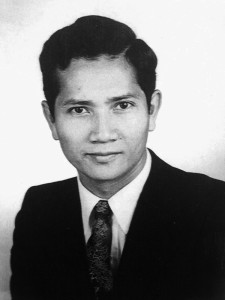 Image of Ouk Ket in a suit